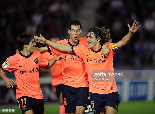 Carles Puyol of Barcelona celebrates with Sergio Busquets and Bojan Krkic after scoring Barcelona's second goal during the La Liga match between...