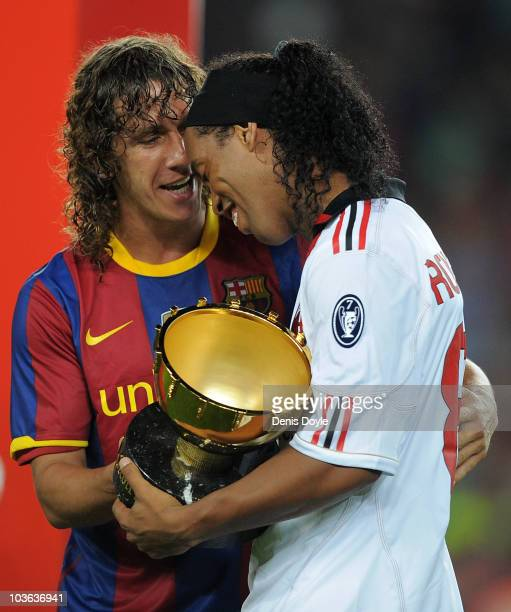 Carles Puyol of Barcelona chats with his former teammate Ronaldinho of AC Milan after the Joan Gamper Trophy match between Barcelona and AC Milan at...