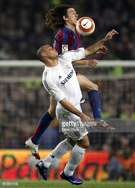 Carles Puyol of Barcelona cuts off Ronaldo of Real Madrid during a Primera Liga match between Barcelona and Real Madrid at the Camp Nou stadium on...