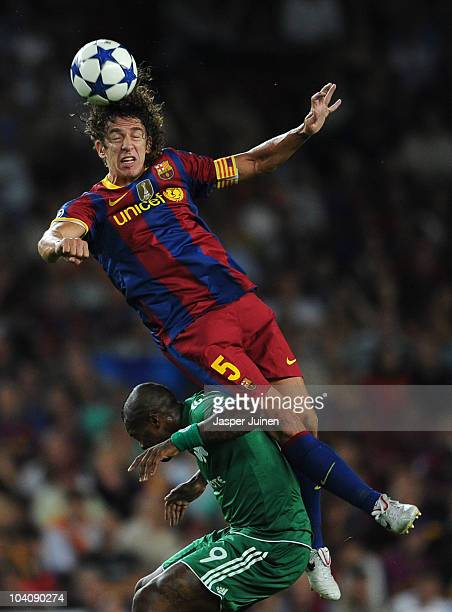 Carles Puyol of Barcelona duels for a high ball with Djibril Cisse of Panathinaikos during the UEFA Champions League group D match between Barcelona...