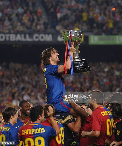 Carles Puyol of Barcelona holds up the La Liga trophy after the La Liga match between Barcelona and Osasuna at the Nou Camp stadium on May 23 2009 in...