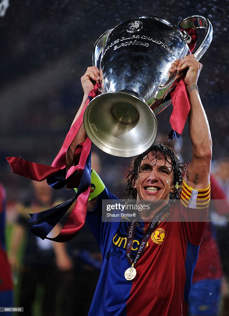Carles Puyol of Barcelona lifts the trophy as he and his team mates celebrates winning the UEFA Champions League Final match between Barcelona and Manchester United at the Stadio Olimpico on May 27, 2009 in Rome, Italy. Barcelona won 2-0.