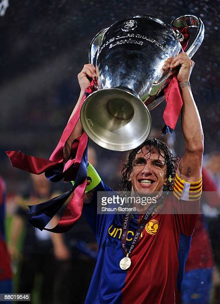 Carles Puyol of Barcelona lifts the trophy as he and his team mates celebrates winning the UEFA Champions League Final match between Barcelona and...