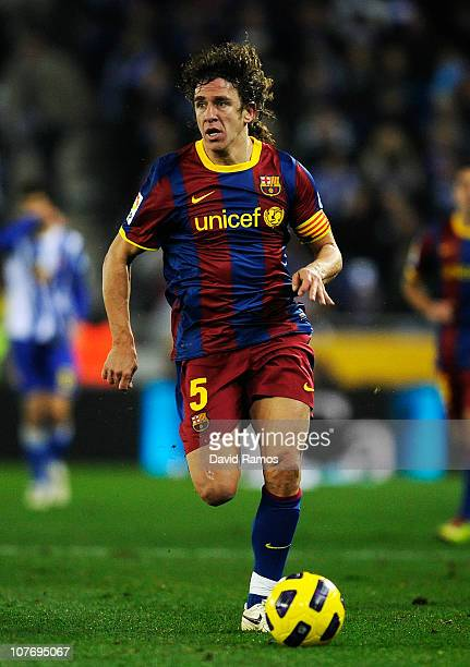 Carles Puyol of Barcelona runs with the ball during the La Liga match between Espanyol and Barcelona at Cornella - El Prat stadium on December 18,...