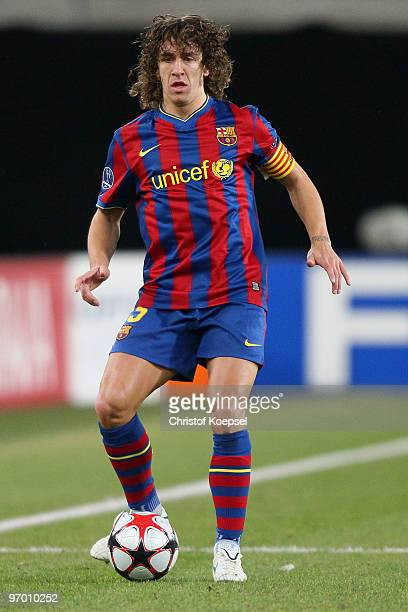 Carles Puyol of Barcelona runs with the ball during the UEFA Champions League round of sixteen first leg match between VfB Stuttgart and FC Barcelona...