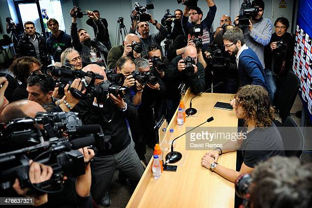 Carles Puyol of FC Barcelona faces the media during a press conference to announce he will be leaving the Catalan club at the end of the season at...