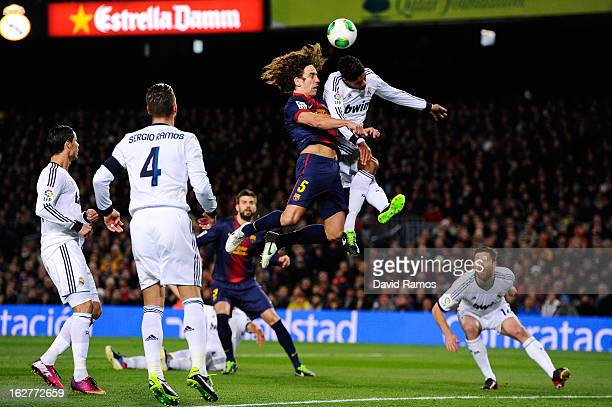 Carles Puyol of FC Barcelona jumps for the ball with Ricardo Varene of Real Madrid CF during the Copa del Rey Semi Final second leg between FC...
