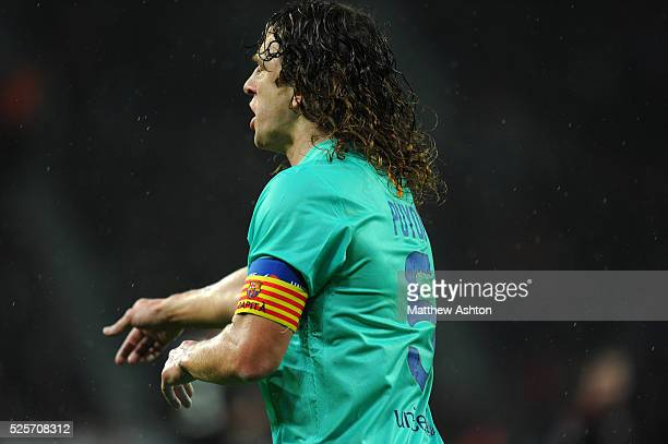 Carles Puyol of FC Barcelona wearing a Catalan captains arm band