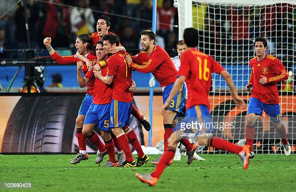 Carles Puyol of Spain celebrates scoring his side's first goal with team mates during the 2010 FIFA World Cup South Africa Semi Final match between...