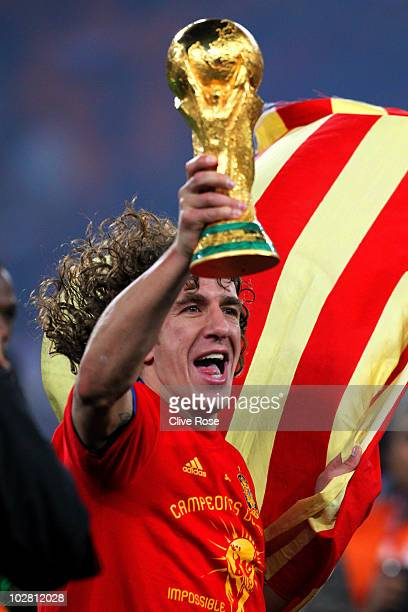 Carles Puyol of Spain celebrates winning the World Cup during the 2010 FIFA World Cup South Africa Final match between Netherlands and Spain at...