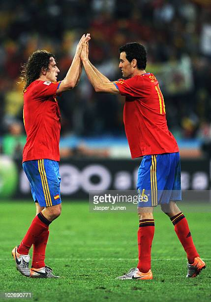 Carles Puyol of Spain celebrates with team mate Sergio Busquets after victory and progress to the final during the 2010 FIFA World Cup South Africa...