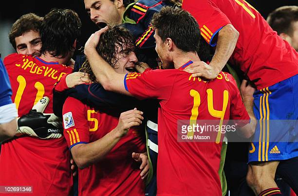 Carles Puyol of Spain celebrates with team mate Xabi Alonso after victory and progress to the final during the 2010 FIFA World Cup South Africa Semi...