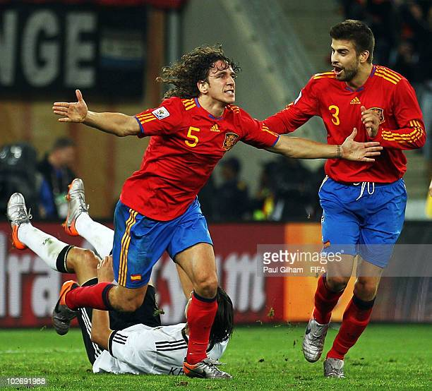 Carles Puyol of Spain celebrates with teammate Gerard Pique after scoring the opening goal during the 2010 FIFA World Cup South Africa Semi Final...