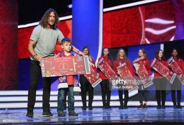 Carles Puyol of Spain greets a Super Fan on the stage after the rehearsal for the 2018 FIFA World Cup Draw at the Kremlin on November 30 2017 in...