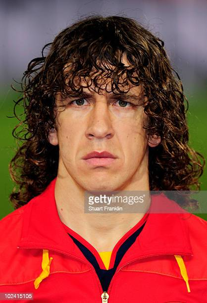 Carles Puyol of Spain lines up for the national anthems prior to the 2010 FIFA World Cup South Africa Group H match between Chile and Spain at Loftus...