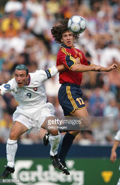 Carles Puyol of Spain outjumps Juraj Czinge of Slovakia during the UEFA European U21 Championships 2000 match on June 4 2000 in Bratislava Slovakia