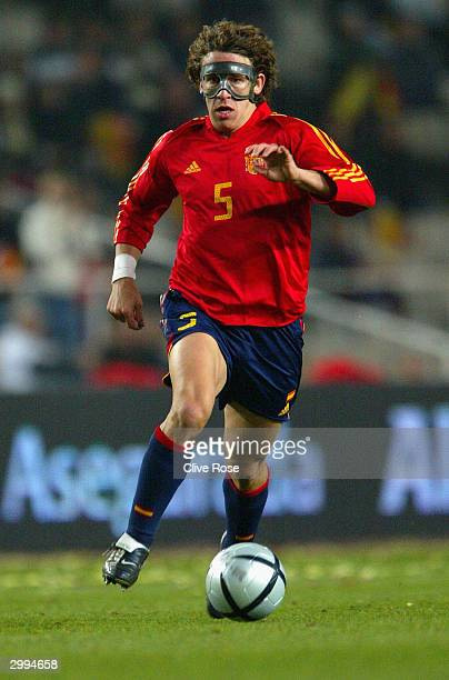 Carles Puyol of Spain wears a protective face mask during the International Friendly match between Spain and Peru at The Olympic Stadium on February...