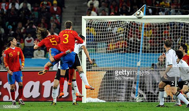 Carles Puyol scores Spain's winning goal during the 2010 FIFA World Cup South Africa Semi Final match between Germany and Spain at Durban Stadium on...