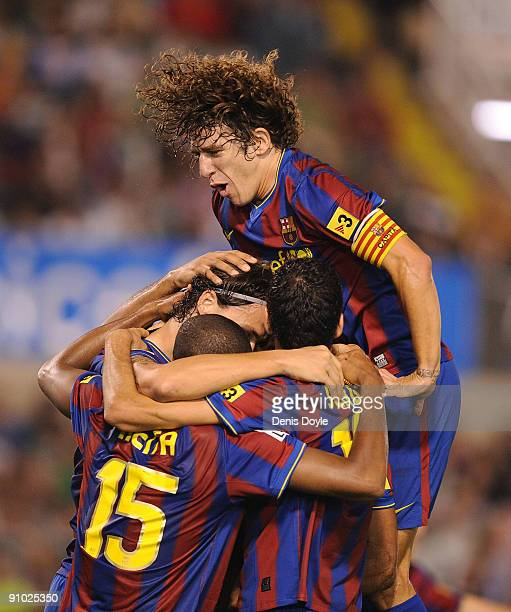 Carles Puyol Seydou Keita and Barcelona teammates celebrate after their first goal is scored by Zlatan Ibrahimovic against Racing Santander during...