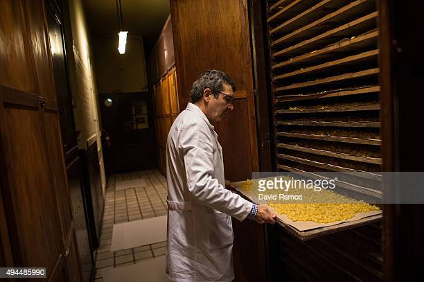 Carles Sanmarti checks 'galets' a Catalan traditional kind of pasta drying in wood cabinets at Pasta Sanmarti factory on October 27 2015 in Caldes de...