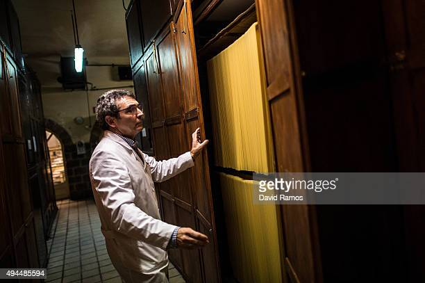 Carles Sanmarti checks noodles drying in wood cabinets at Pasta Sanmarti factory on October 27 2015 in Caldes de Montbui Spain The Sanmarti family...