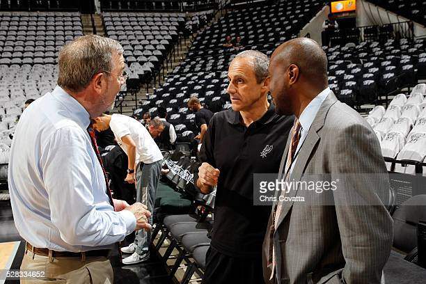 J Carlesimo and Assistant Coach Ettore Messina of the San Antonio Spurs talk before the game against the Oklahoma City Thunder in Game One of the...