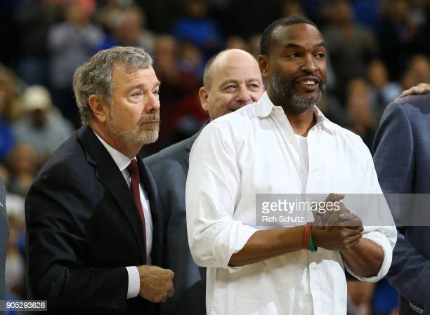 P J Carlesimo and Terry Dehere along with other members of the '92'93 Big East Champion team were honored during a game between the Georgetown Hoyas...