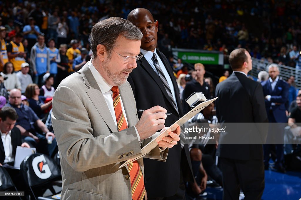 P.J. Carlesimo of the Brooklyn Nets draws up plays from the bench before the game against the Denver Nuggets on March 29, 2013 at the Pepsi Center in Denver, Colorado.