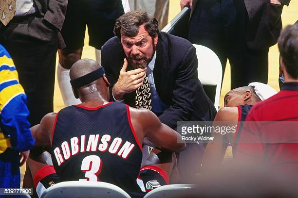 J Carlesimo of the Portland Trail Blazers coaches his team against the Golden State Warriors circa 1996 at OaklandAlameda County Coliseum in Oakland...