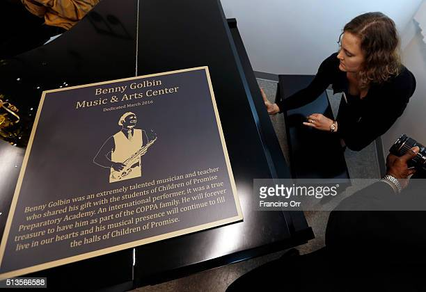 Carli Golbin puts a name on Benny Goldbin's piano during a dedication at Children of Promise Preparatory Academy in Inglewood CA March 3 2016 Carli...