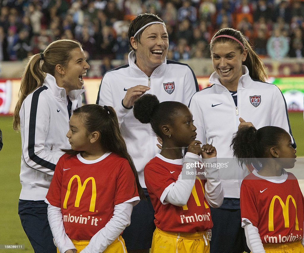 Carli Lloyd, Abby Wambach and Alex Morgan, from left, during pre-game ceremonies at BBVA Compass Stadium on December 12, 2012 in Houston, Texas. USA won 4-0.