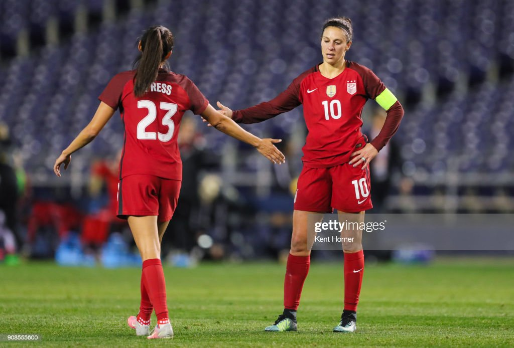 Carli Lloyd #10 and Christen Press of the U.S. women's national team high-five after the conclusion of the game against the Danish women's national team at SDCCU Stadium on January 21, 2018 in San Diego, California.