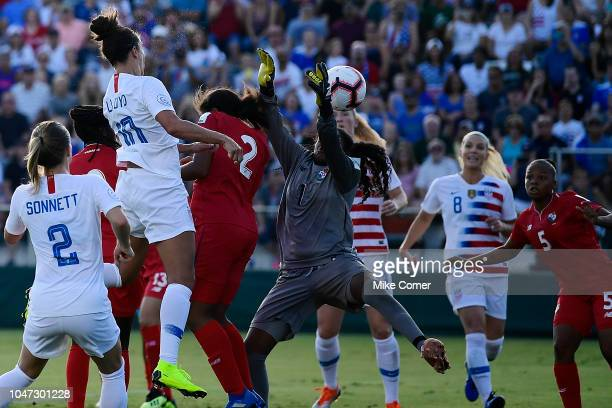 Carli Lloyd heads the ball past Yenith Bailey of Panama for a goal during the soccer game at WakeMed Soccer Park on October 7 2018 in Cary North...