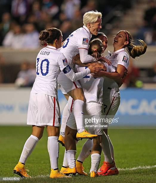 Carli Lloyd Megan Rapinoe Tobin Heath Sydney Leroux and Alex Morgan of the United States celebrate a first half goal against Guatemala during the...