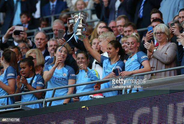 Carli Lloyd of Manchester City Women celebrates with the trophy during the SSE Women's FA Cup Final between Birmingham City Ladies and Manchester...