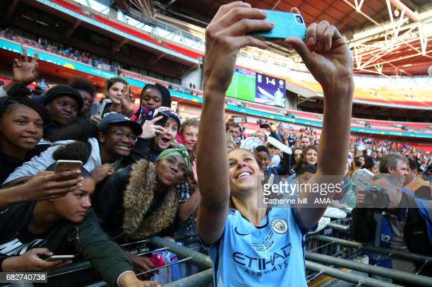 Carli Lloyd of Manchester City Women takes a selfie photo with the fans during the SSE Women's FA Cup Final between Birmingham City Ladies and...