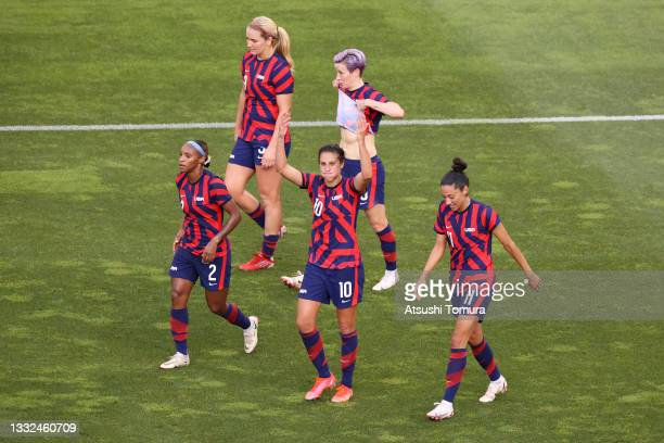 Carli Lloyd of Team United States celebrates with Crystal Dunn and Christen Press after scoring their side's third goal during the Women's Bronze...