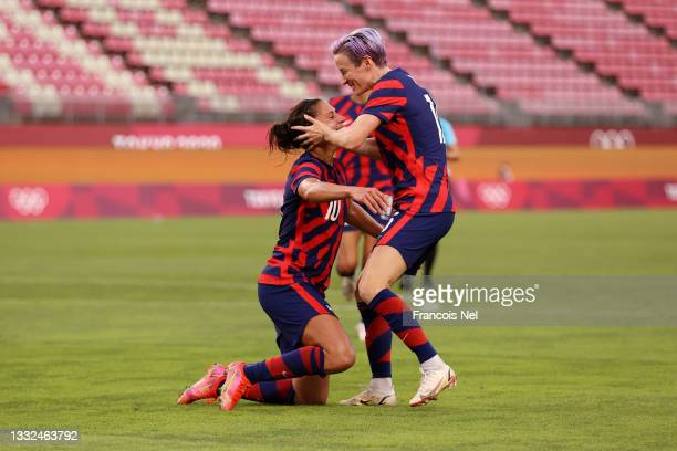 Carli Lloyd of Team United States celebrates with Megan Rapinoe after scoring their side's fourth goal during the Women's Bronze Medal match between...