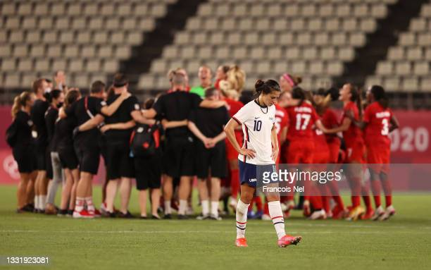Carli Lloyd of Team United States looks dejected following defeat in the Women's Semi-Final match between USA and Canada on day ten of the Tokyo...