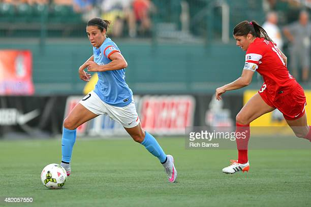 Carli Lloyd of the Houston Dash controls the ball in front of Brittany Taylor of the Western New York Flash during the first half at Sahlen's Stadium...
