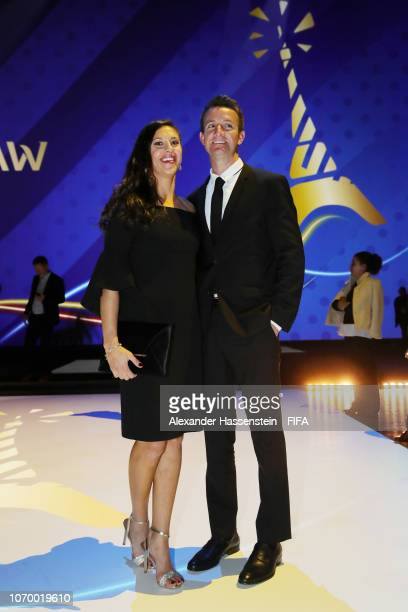Carli Lloyd of the United States and guest pose during the FIFA Women's World Cup France 2019 Draw at La Seine Musicale on December 8 2018 in Paris...