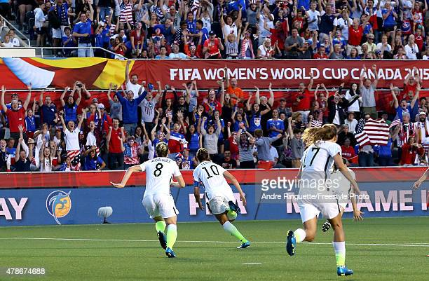 Carli Lloyd of the United States celebrates scoring the first goal against China in the FIFA Women's World Cup 2015 Quarter Final match at Lansdowne...