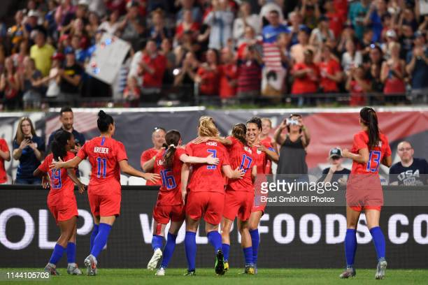 Carli Lloyd of the United States celebrates scoring with teammates during an international friendly between the women's national teams of the United...
