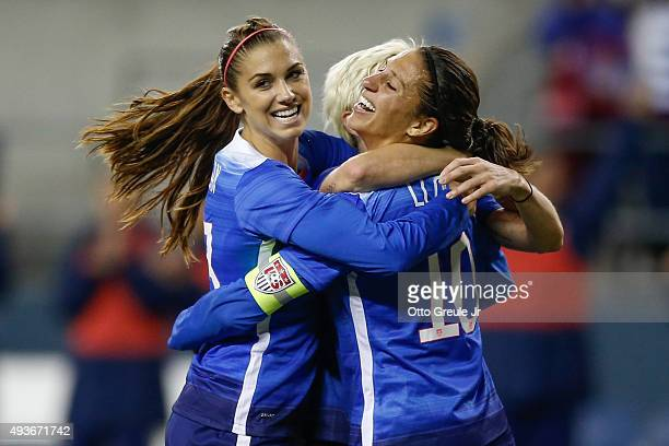 Carli Lloyd of the United States celebrates with Alex Morgan after scoring a goal against Brazil in the second half at CenturyLink Field on October...