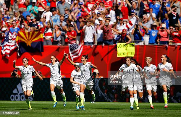 Carli Lloyd of the United States celebrates with teammates after scoring her second goal against Japan in the FIFA Women's World Cup Canada 2015...