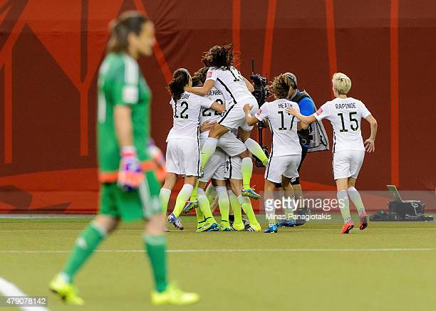 Carli Lloyd of the United States celebrates with teammates after scoring on a penalty kick for the opening goal against Germany in the FIFA Women's...