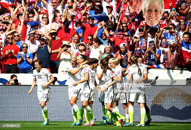 Carli Lloyd of the United States celebrates with teammates after scoring the opening goal against Japan in the FIFA Women's World Cup Canada 2015...
