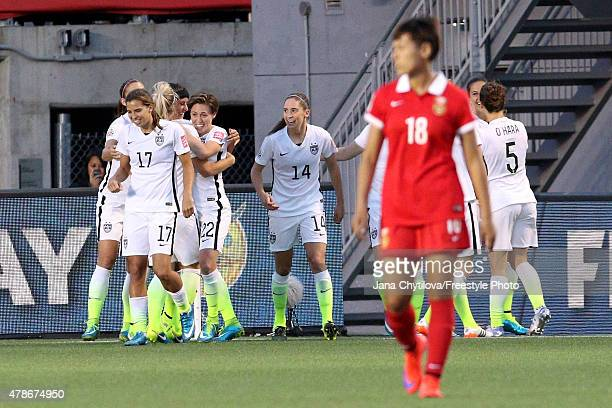 Carli Lloyd of the United States celebrates with teammates in the second half after scoring her team's first goal against China in the FIFA Women's...
