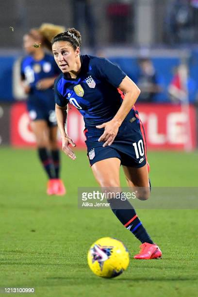 Carli Lloyd of the United States chases runs with the ball during the second half of the SheBelieves Cup match against Japan at Toyota Stadium on...