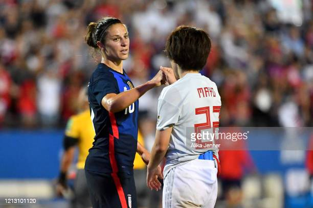 Carli Lloyd of the United States fist bumps Mayo Doko of Japan after the SheBelieves Cup match at Toyota Stadium on March 11 2020 in Frisco Texas The...